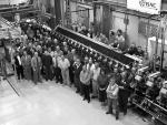 [Photo of TRIUMF Staff pictured with the ISAC Radio Frequency Quadrupole.]