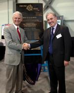 [Photo of TRIUMF Director Alan Shotter and Gordon Cambell with the ISAC-II Plaque.]
